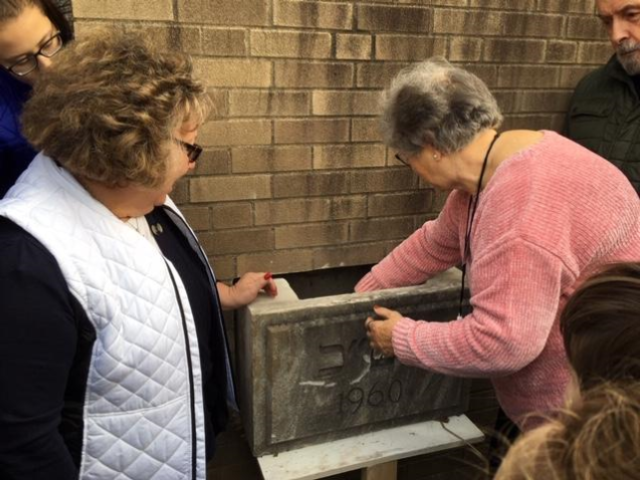 Kay Liss and JoAnn White install the time capsule