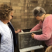 Kay Liss and JoAnn White install the time capsule thumbnail